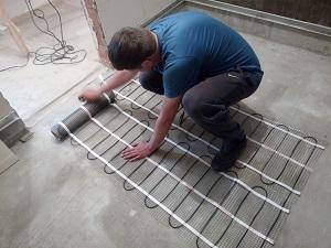 Монтаж теплої підлоги під плитку Україна